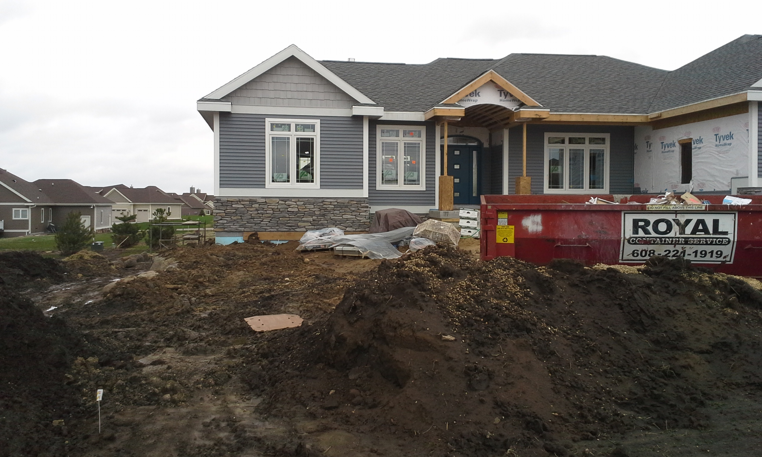 Making progress in building Madison Parade of Homes 2014 Landscaping
